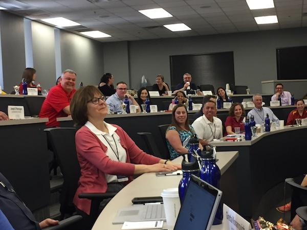 Attendees enjoy a light-hearted moment while sharing industry insights